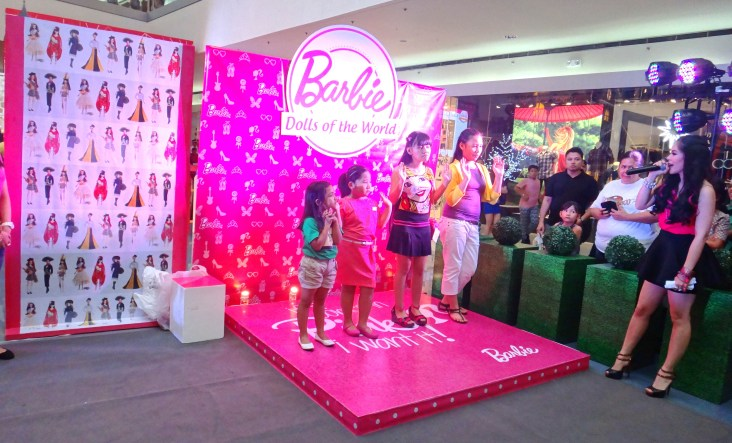 MARYLAINE VIERNES leads the pack of Barbie girls during the Barbie Dolls of the World activity!